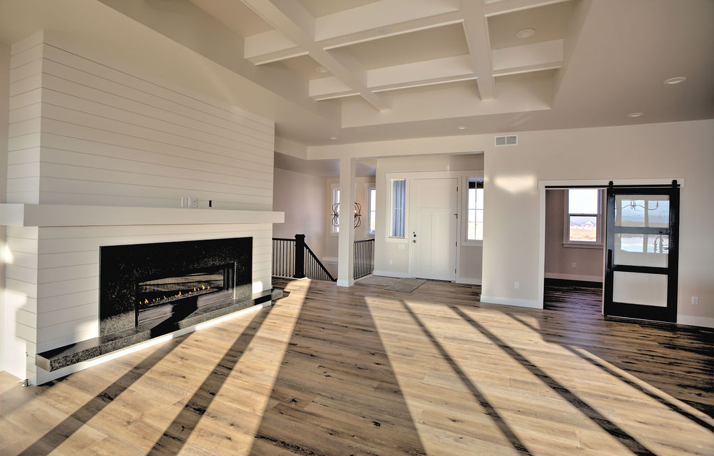 empty room with fireplace and hardwood floors