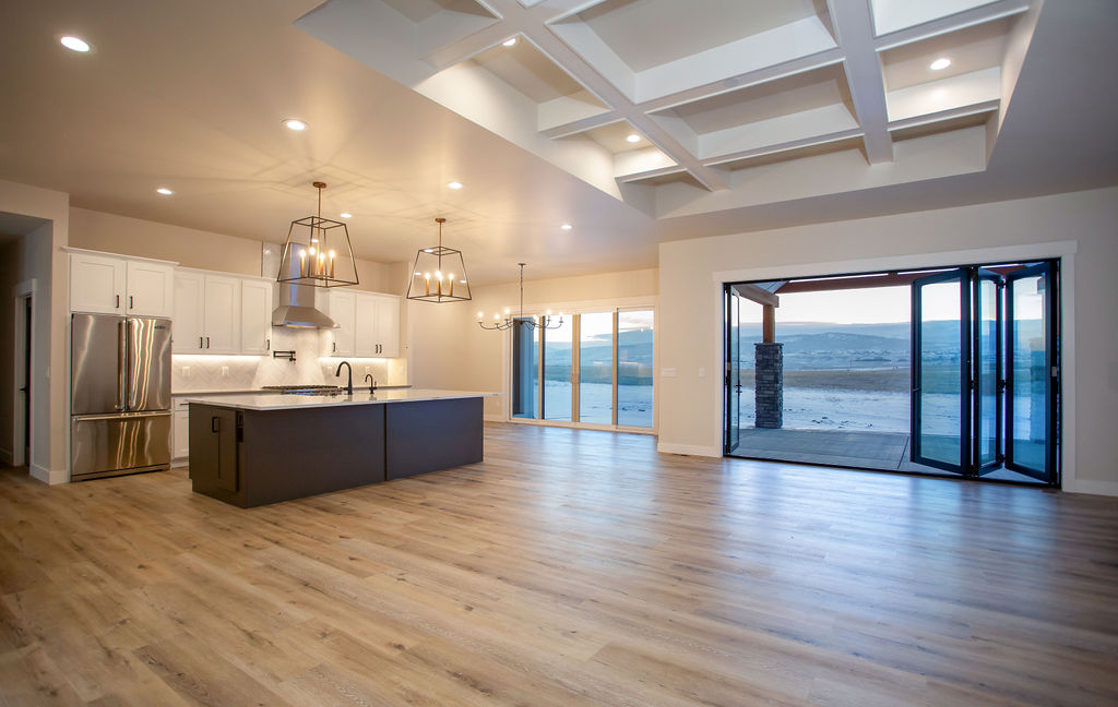 view of a modern kitchen with hardwood floors and an island with open windows