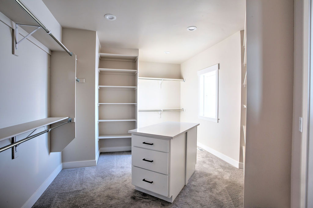 empty closet with central isle