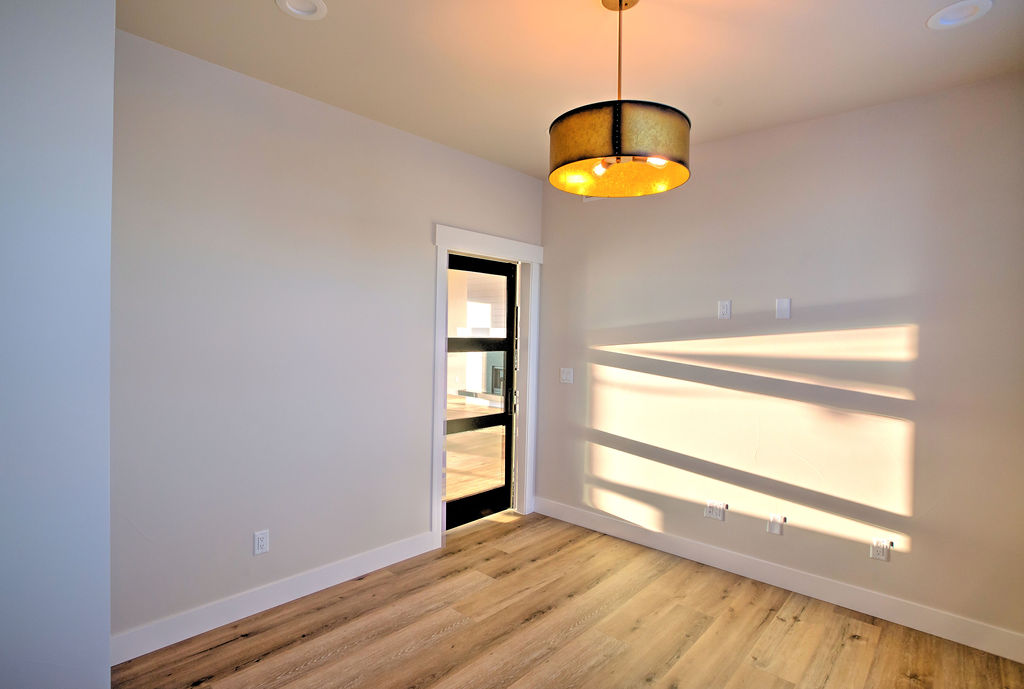 empty room with orange lighting fixture