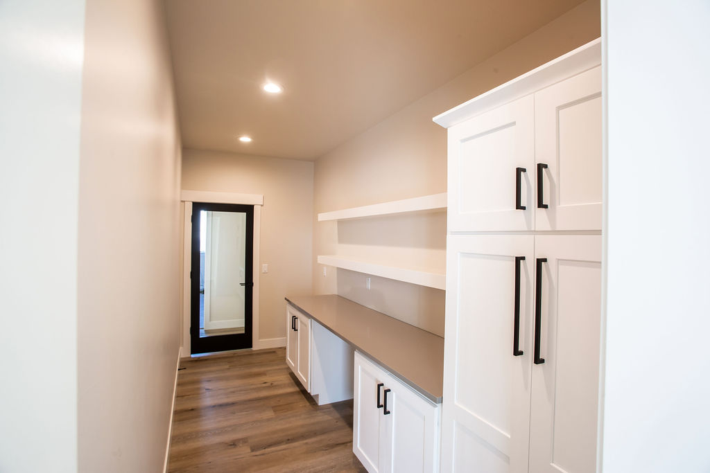 small room with white cabinets