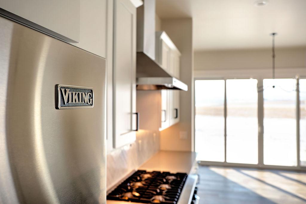 refrigerator door with view the kitchen range