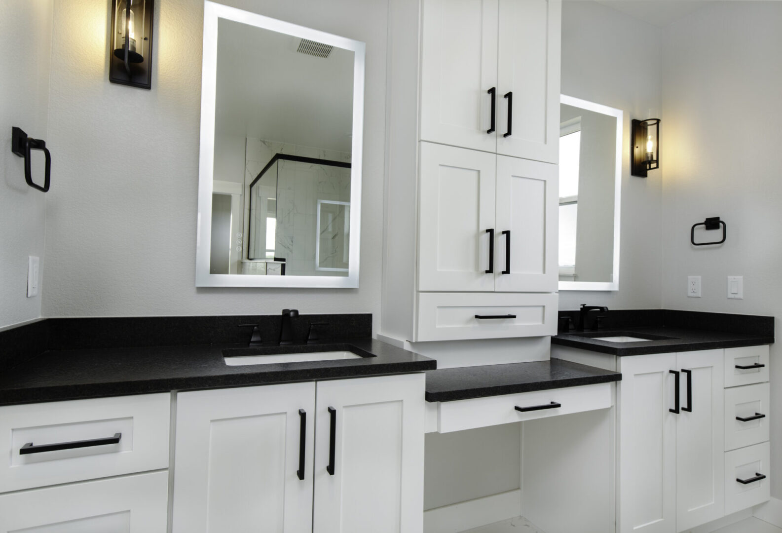 bathroom sinks and mirrors with cabinet