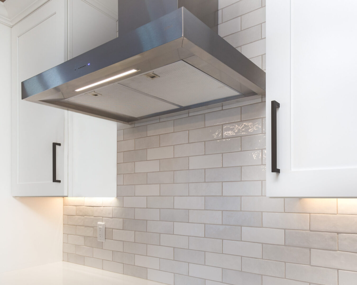 kitchen exhaust with white tiling background