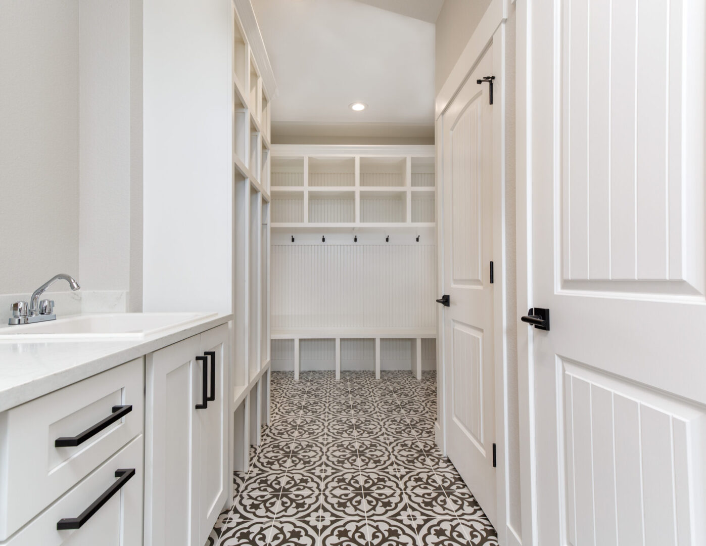 bathroom with white empty cabinets