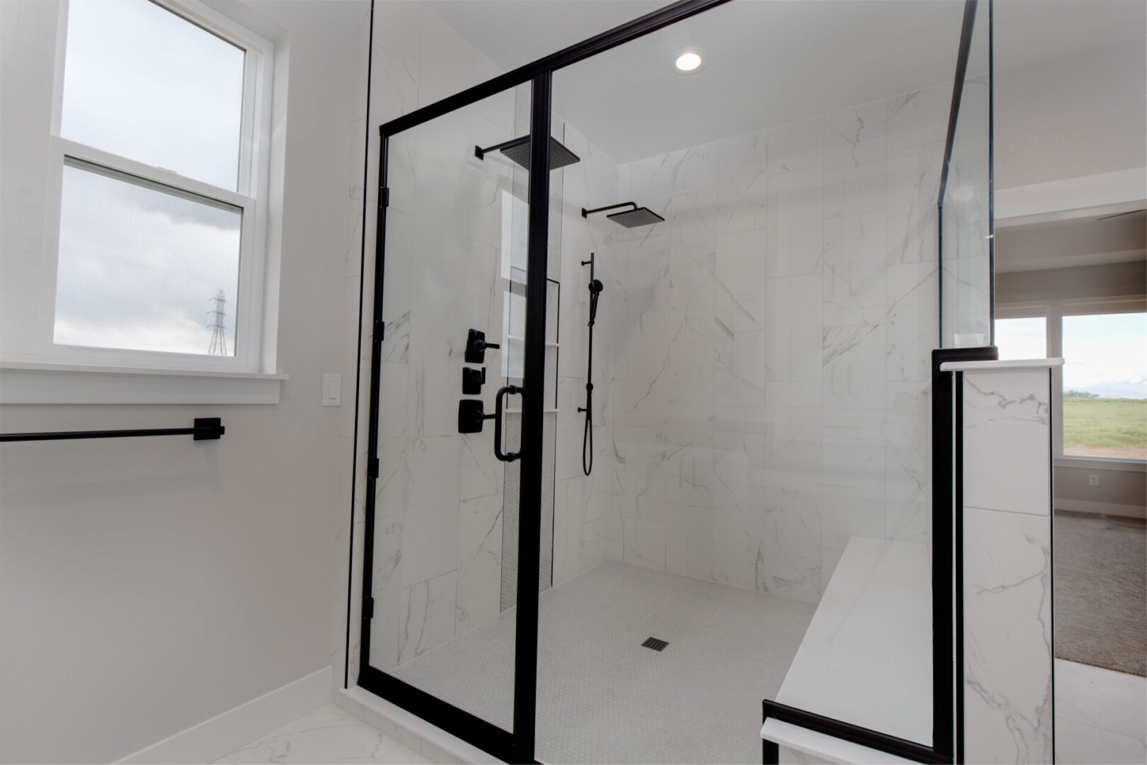 shower enclosure with marble tiles