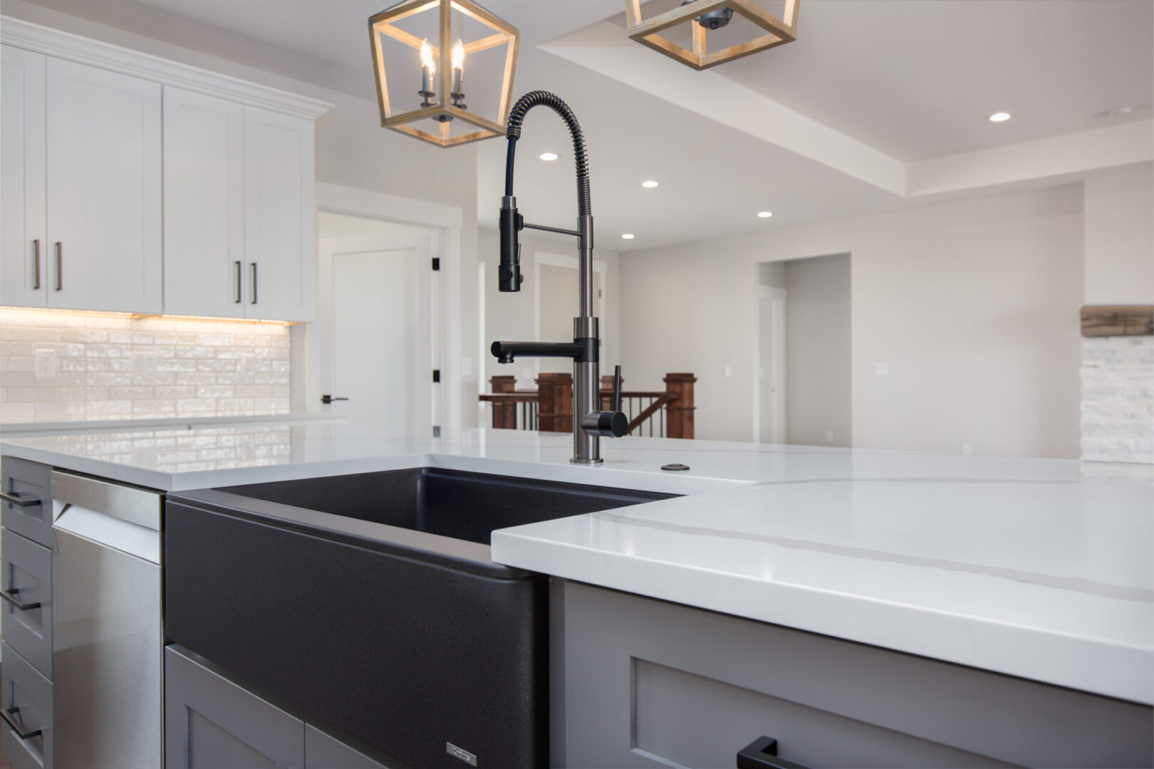 modern faucet of a white-themed kitchen