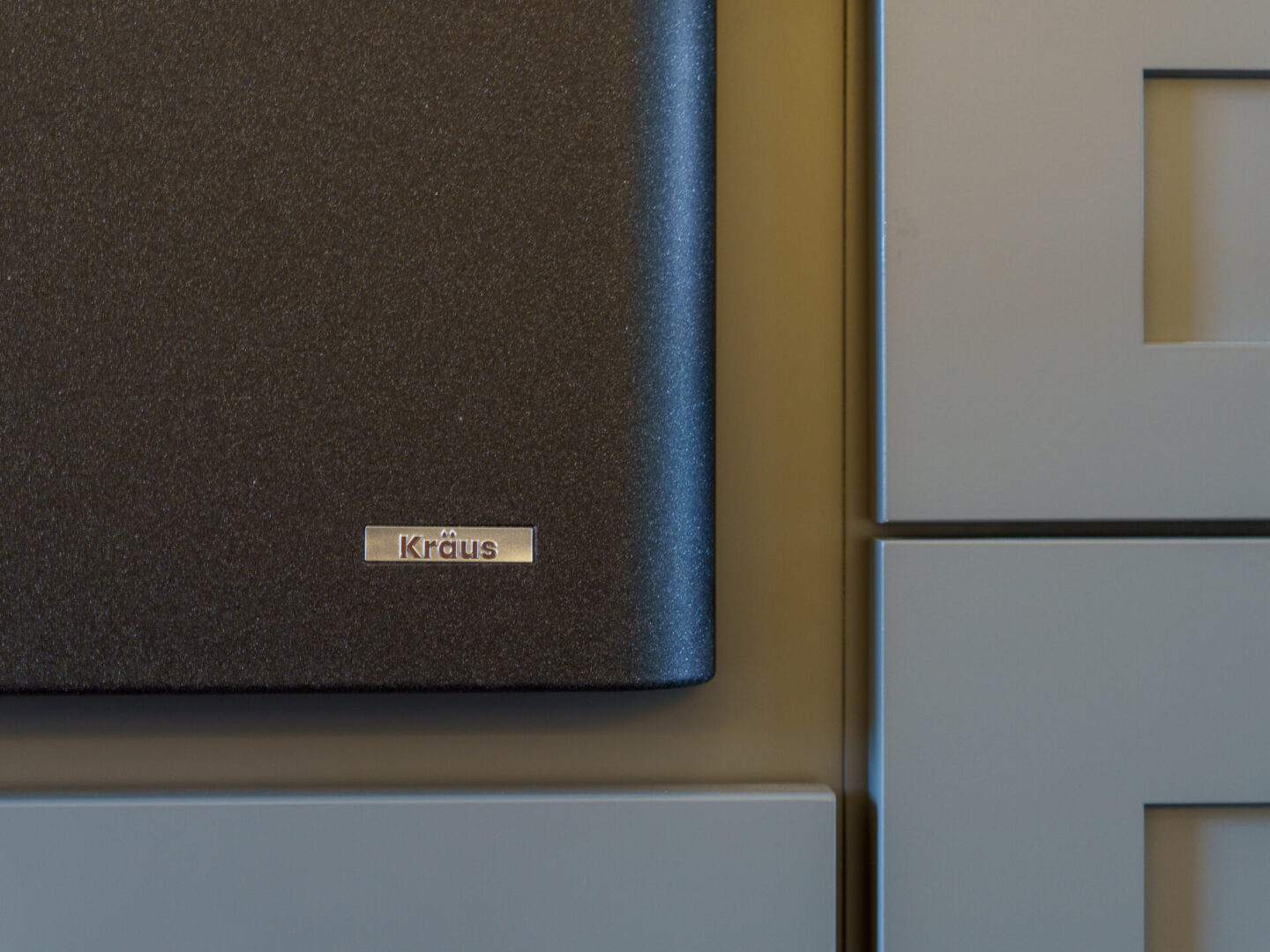 corner of a kitchen appliance with brand name