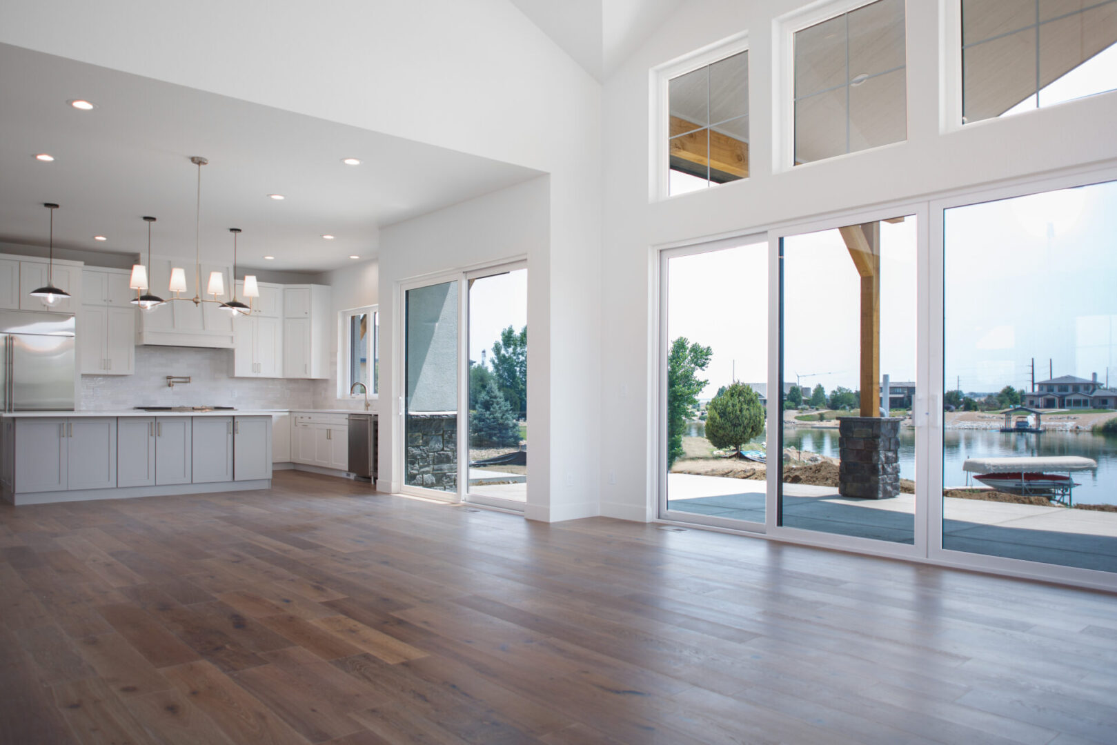 empty room with large windows and kitchen isle