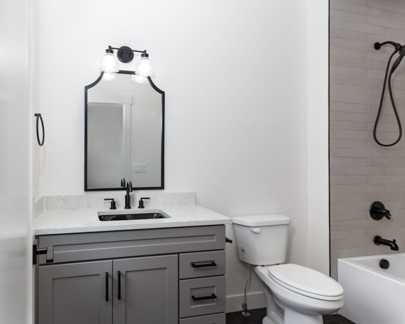 bathroom sink and toilet with bold black outlines