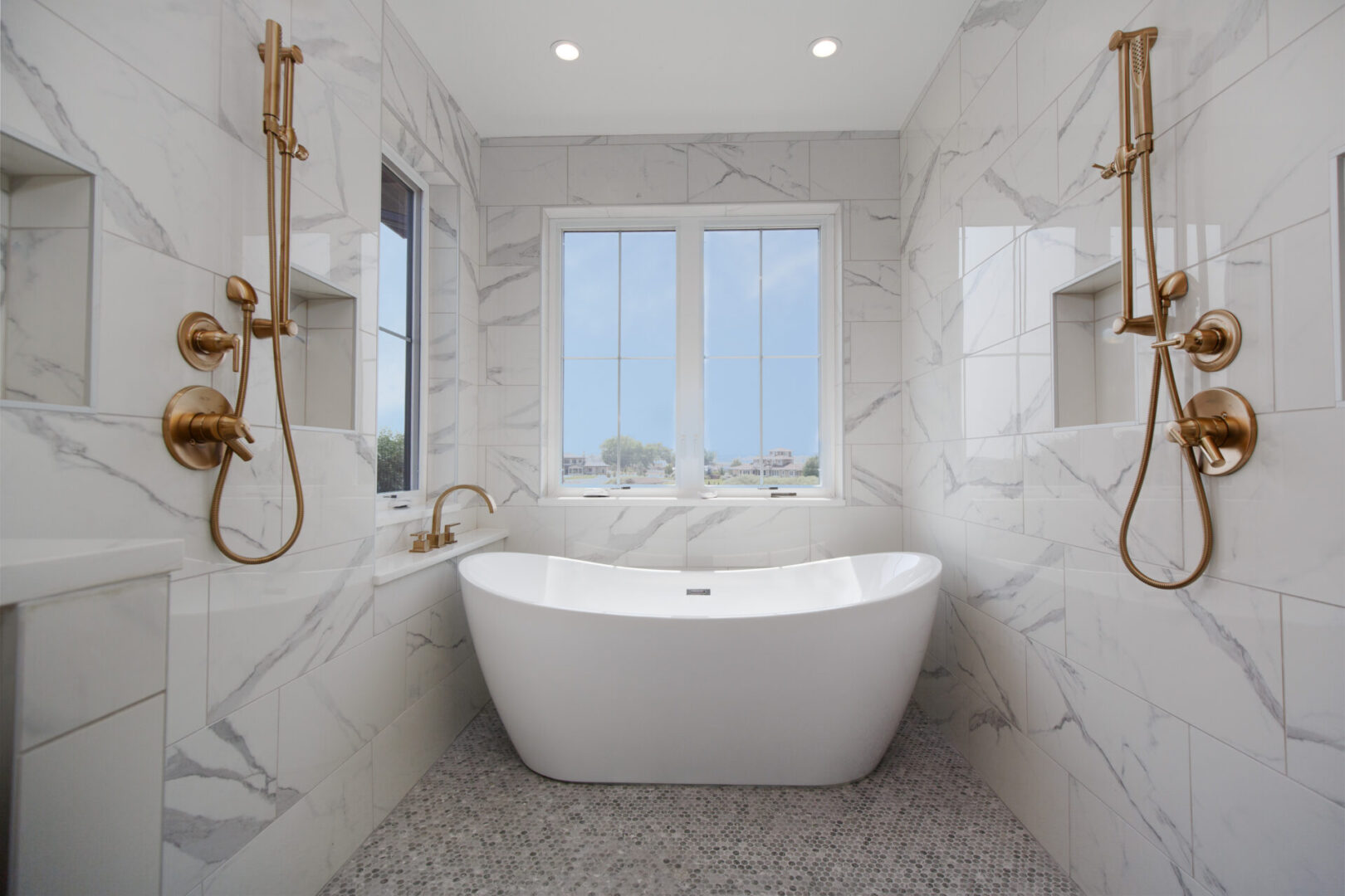 modern bathroom with tub and showers and marbled tiles