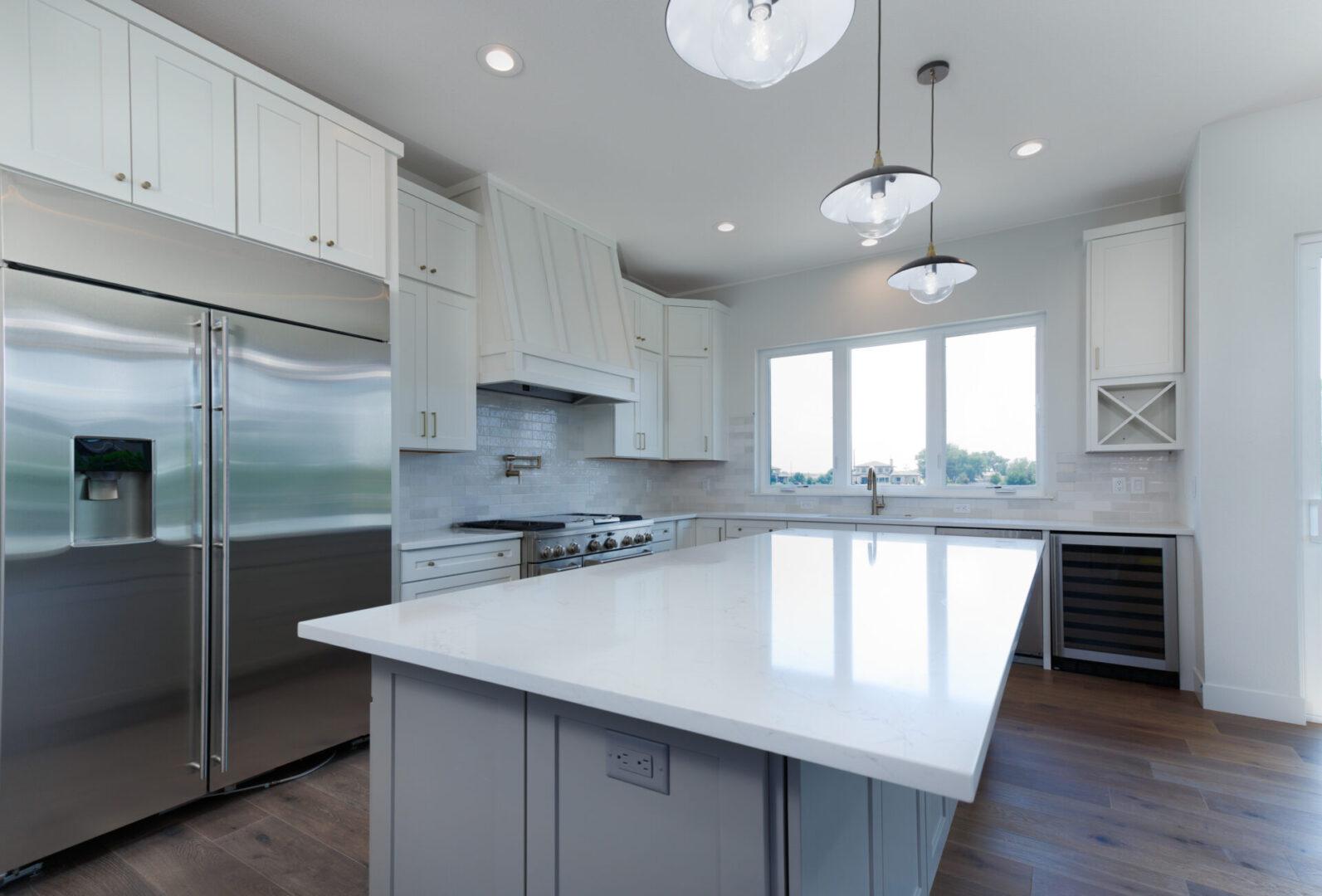 white-themed kitchen with white countertop