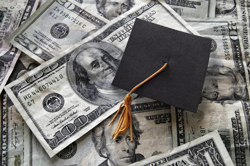 Small graduation cap on assorted cash