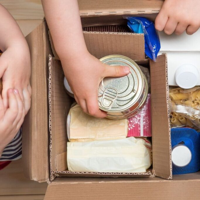 children-opening-food-box