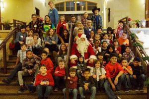 A group photo with Santa Claus by the Stairs