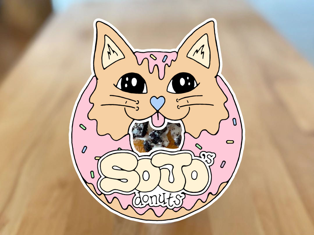 SoJo's Donut logo with donut in the background on a table