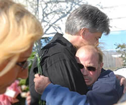 Mark Steinway comforts John Bozes during the memorial ceremony held in front of P.G.T. Beauregard Middle School in St. Bernard, LA. The school was the sight of 33 pets allegedly slaughtered by St. Bernard Sheriffs in the days following Katrina.