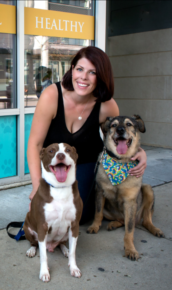 team member with two dogs