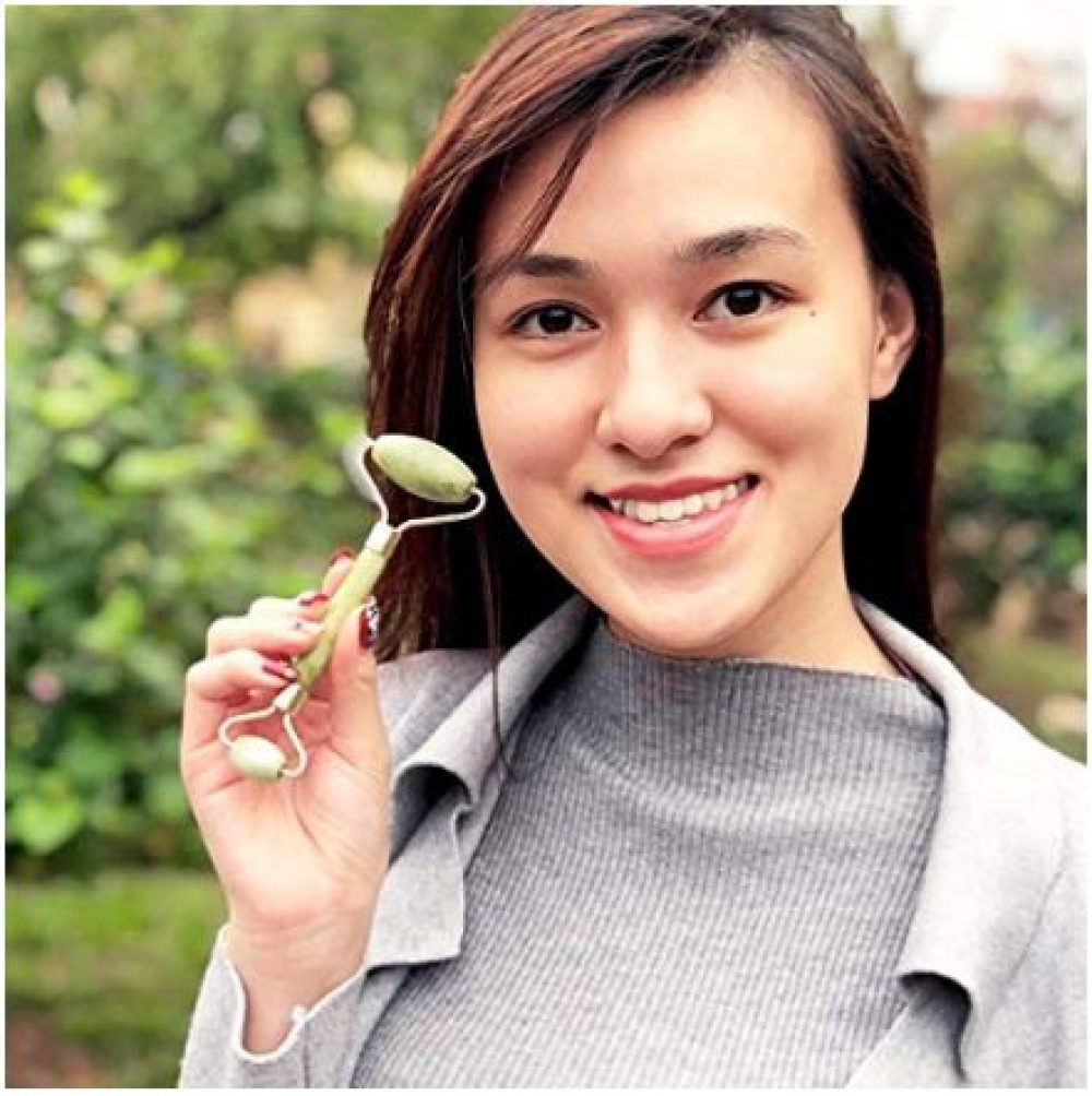 Woman holding original natural jade stone