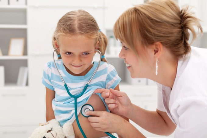 Kid getting checkup from doctor