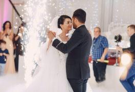 elegant brides in the restaurant dance their first wedding dance