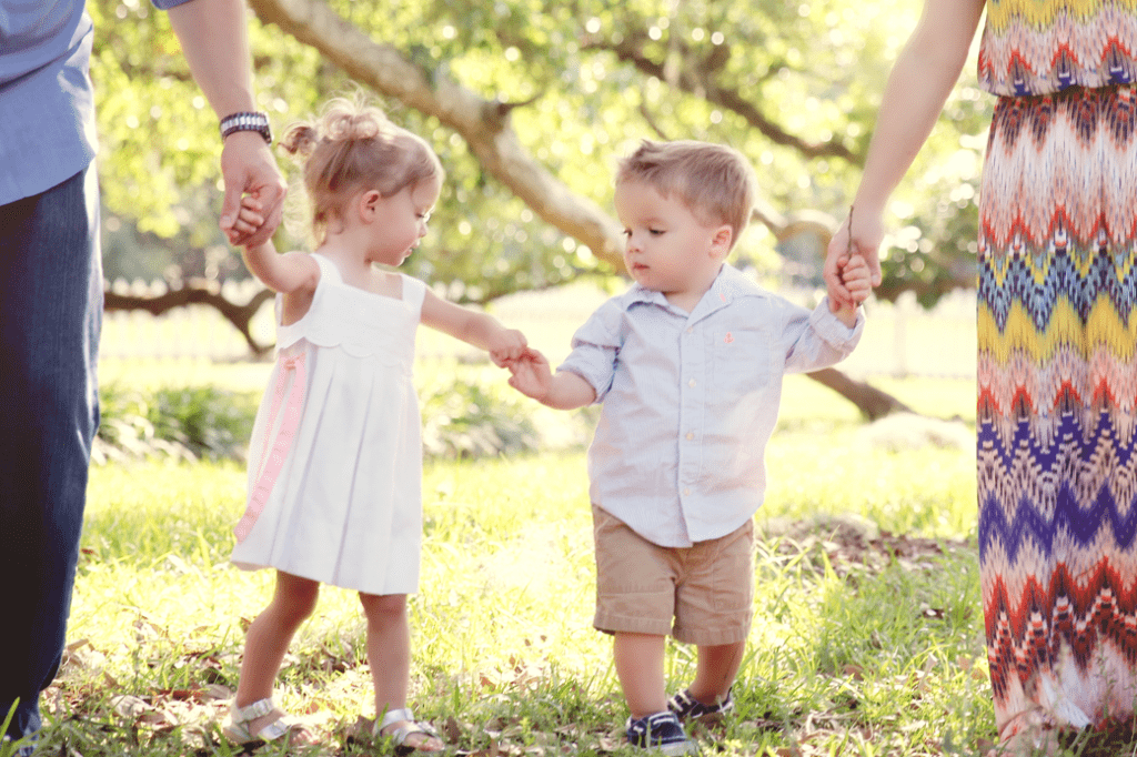 2 year old twins holding hands at Fairview State Park in Madisonville, LA