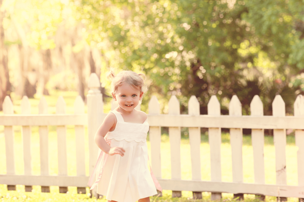 2 year old girl running at Fairview State Park in Madisonville, LA
