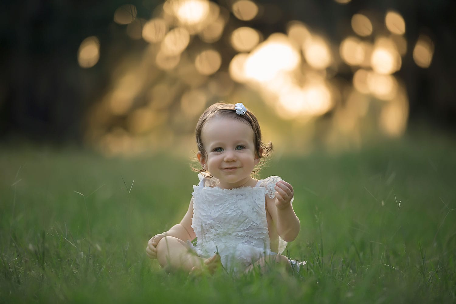 Beautiful one year old girl at sunset by Annie Whitaker Photography