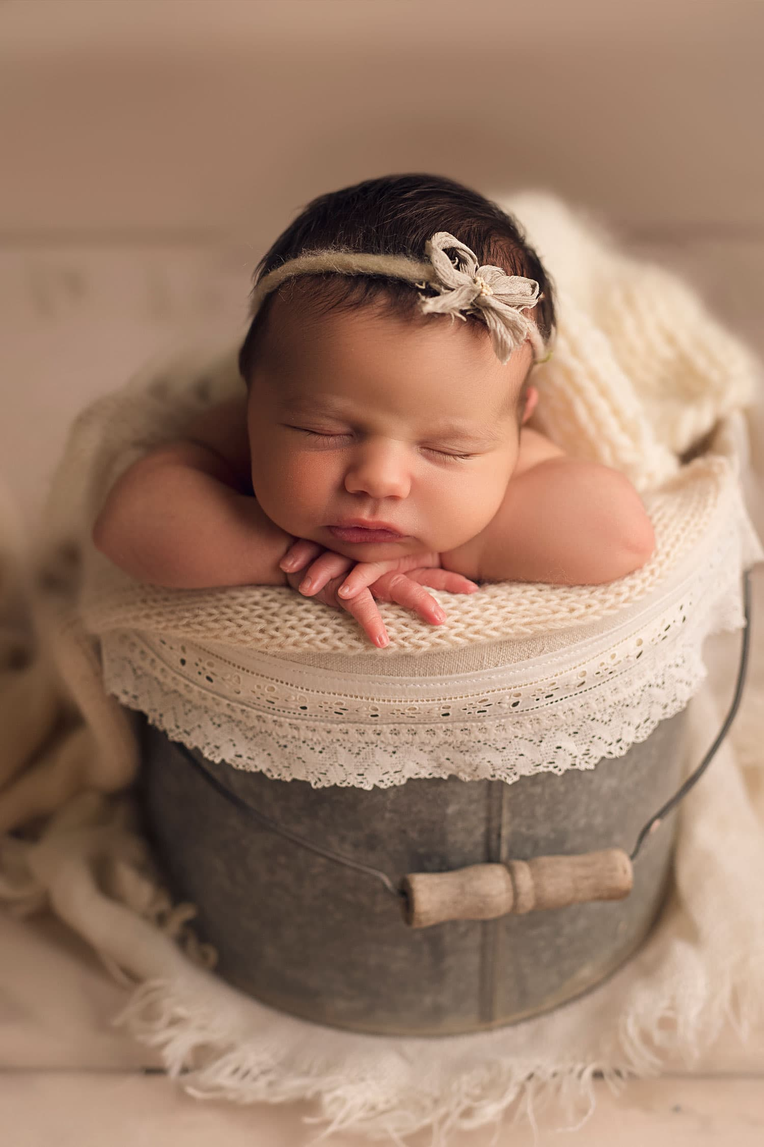 sweet baby girl in bucket with bow by Annie Whitaker Photography