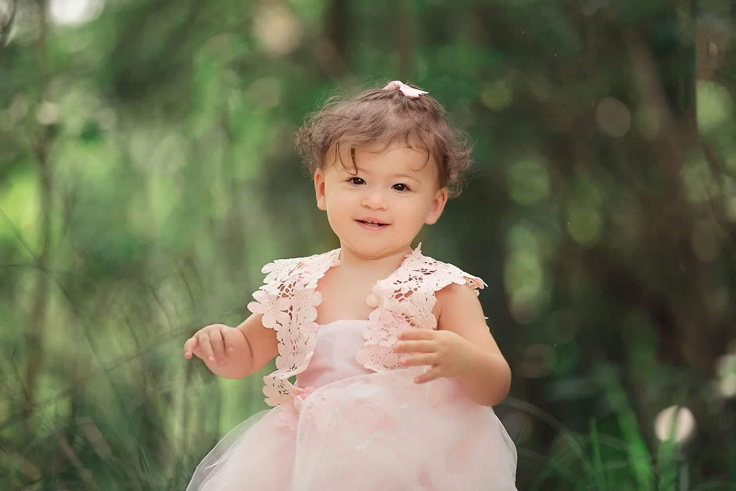 14 month old baby girl in pink dress by Annie Whitaker PHotography