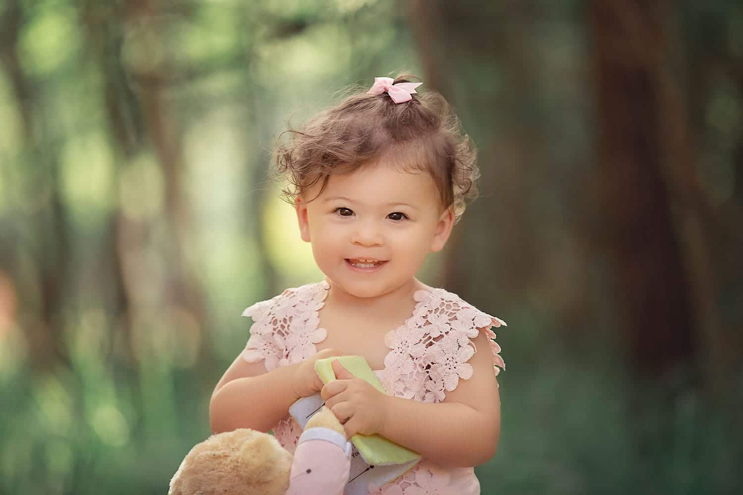 Baby girl holding Teddy bear by Annie Whitaker Photography