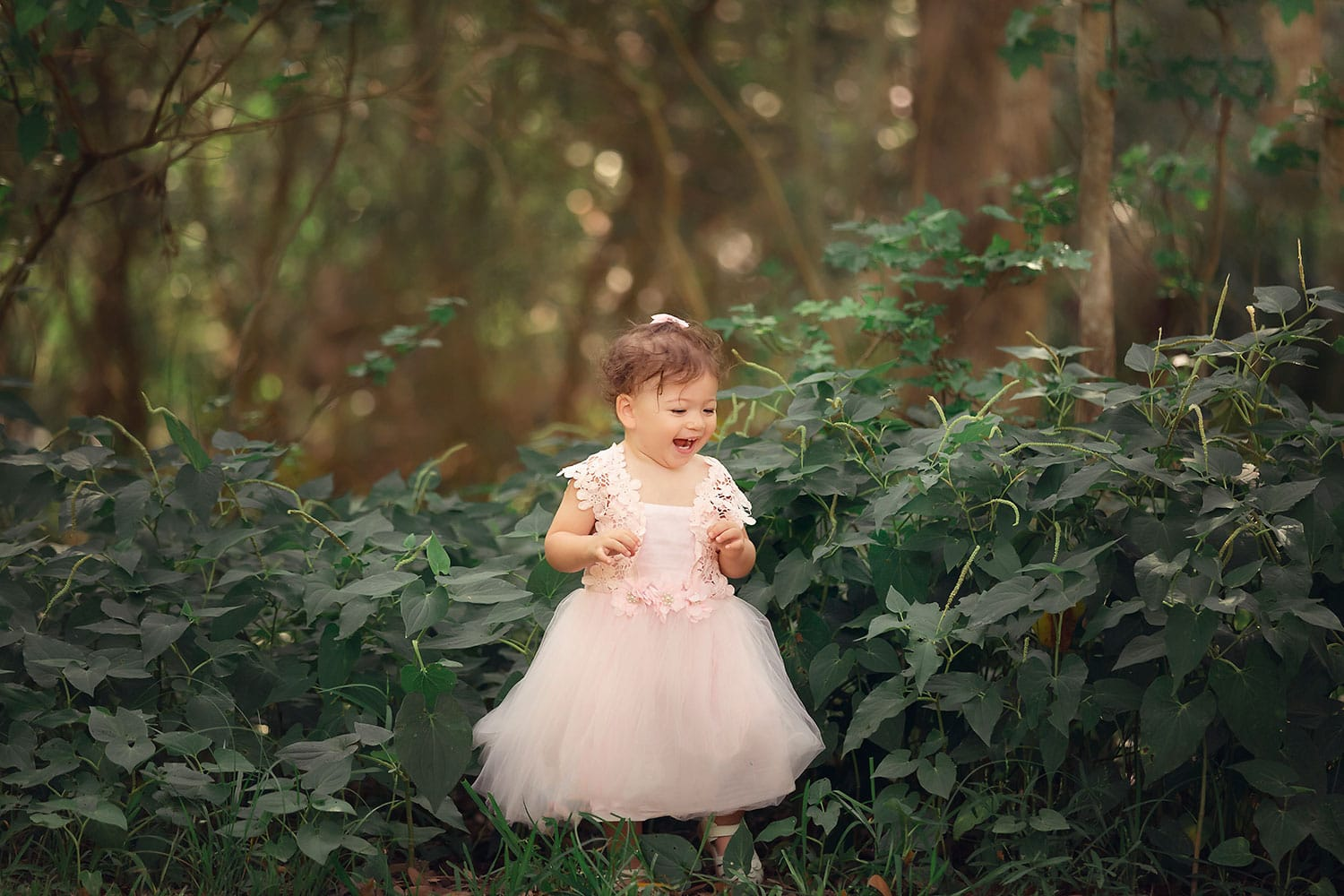 baby girl in greenery by Annie Whitaker Photography