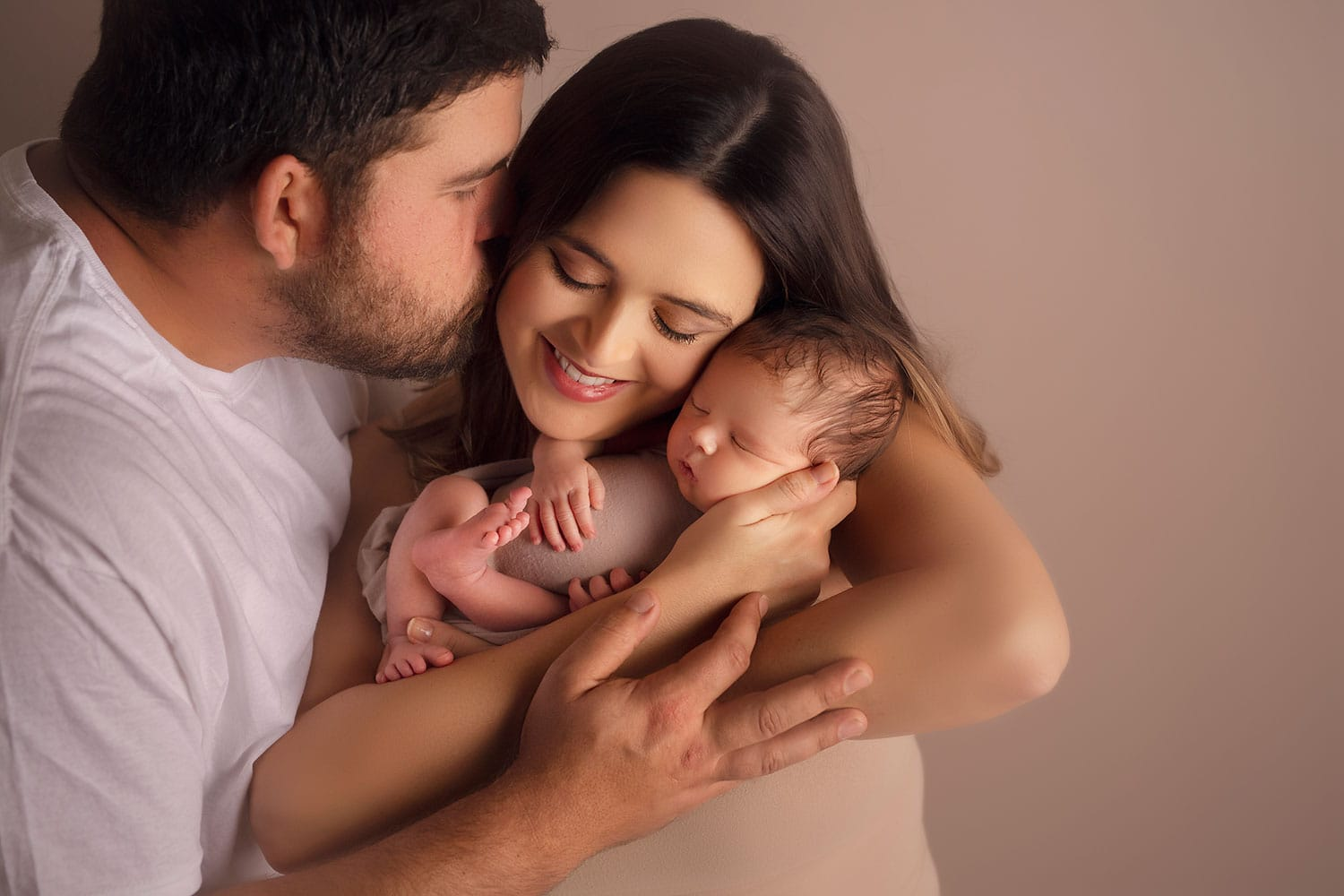 Beautiful photo of mother and father with newborn by Annie Whitaker PHotography