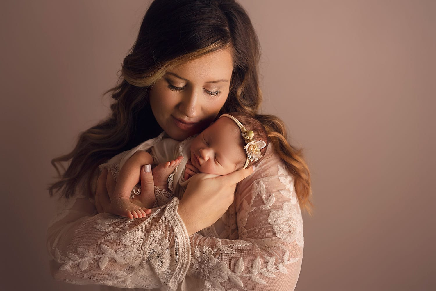 beautiful new mother cradling her newborn by Annie Whitaker Photography