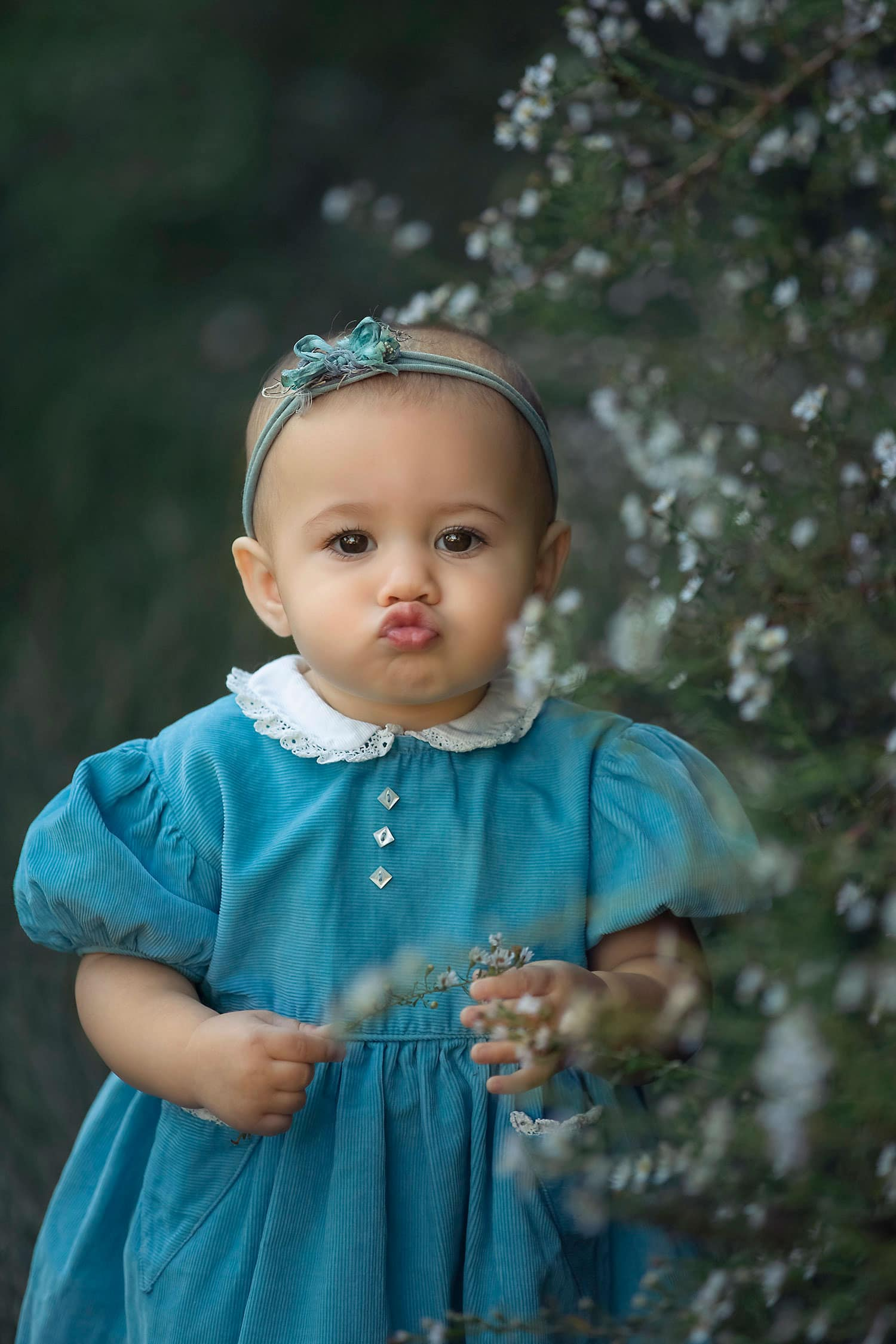 Baby girl making kissy face by Annie Whitaker Photography