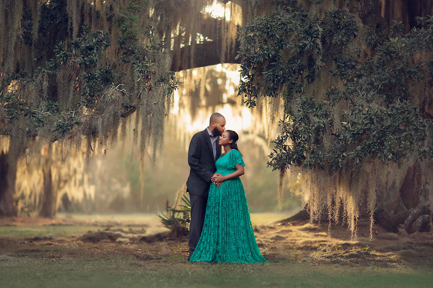 New Orleans maternity session under oak trees at sunset