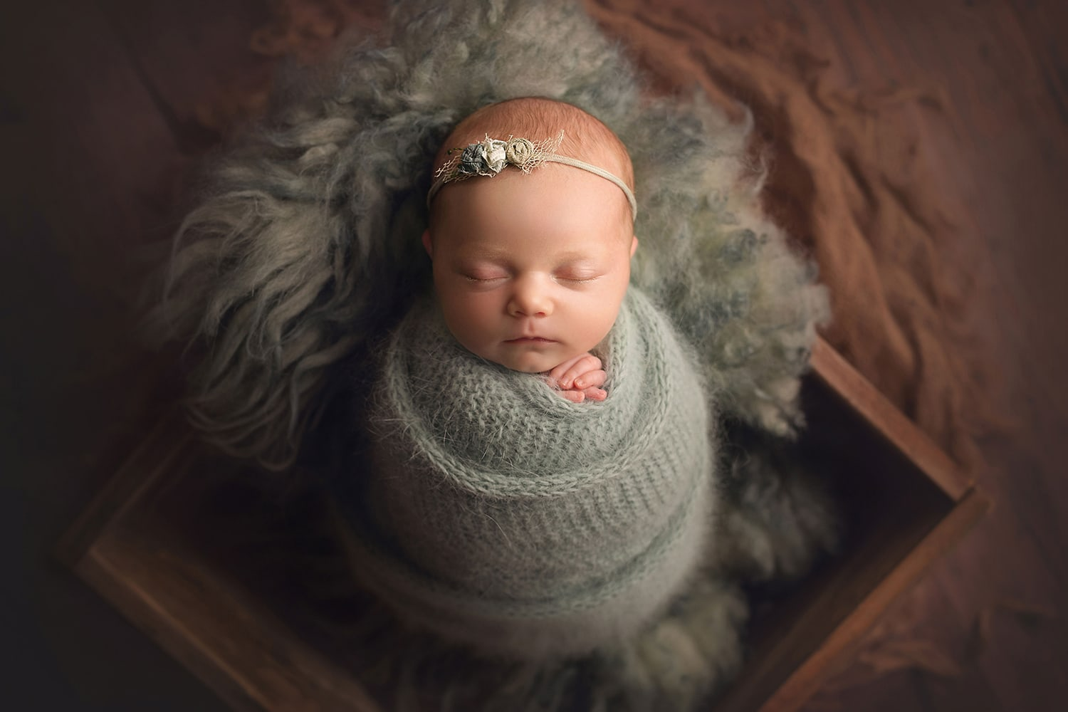 Beautiful baby girl in minty teal wrap by Annie Whitaker photography