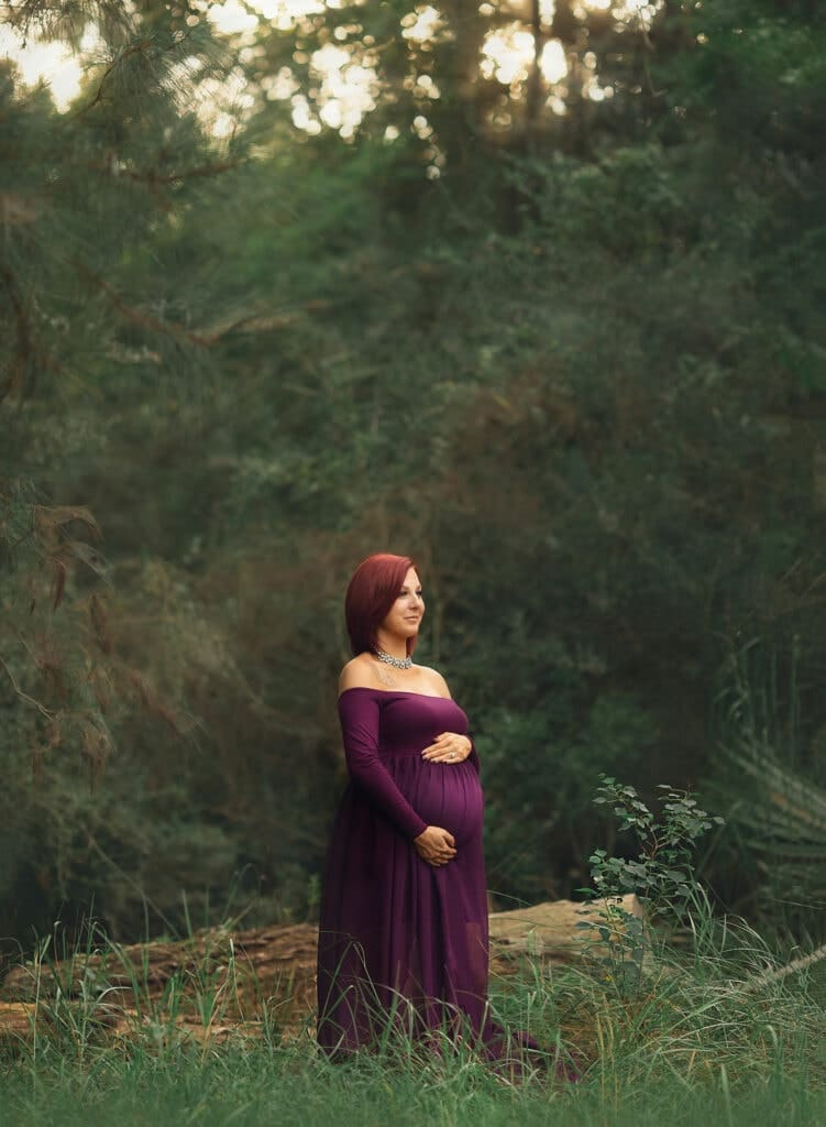 Expecting mother in plum gown