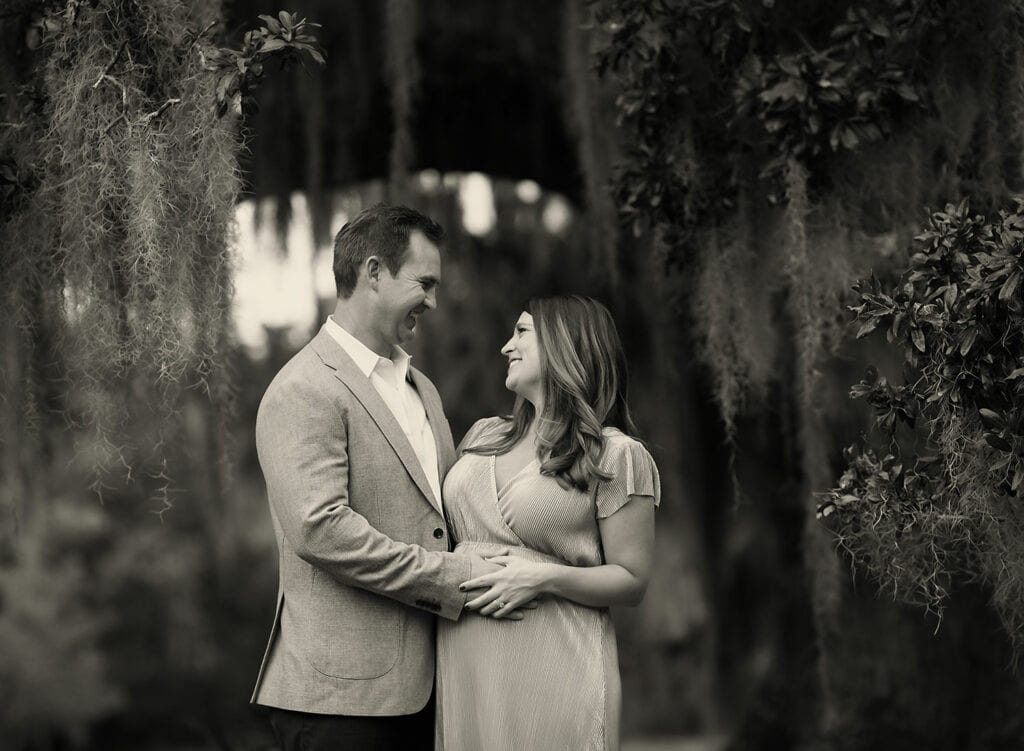 black and white photo of expecting couple
