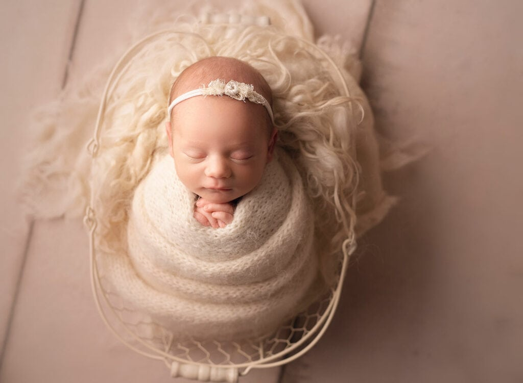 perfect newborn wrapped in basket