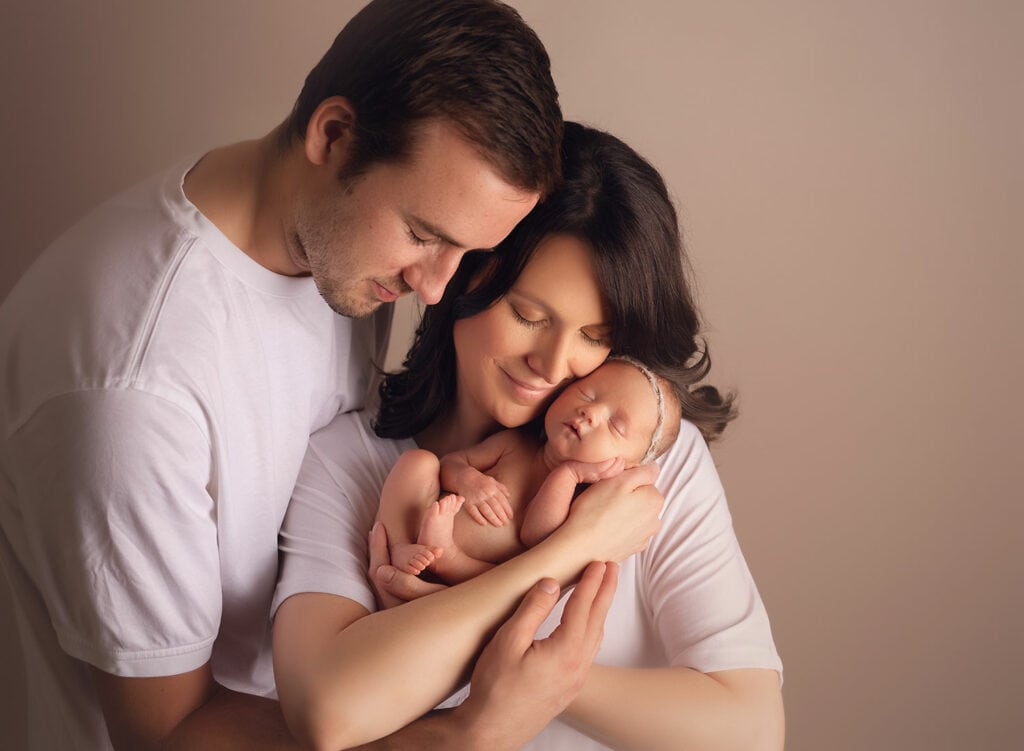 mom and dad with new baby girl
