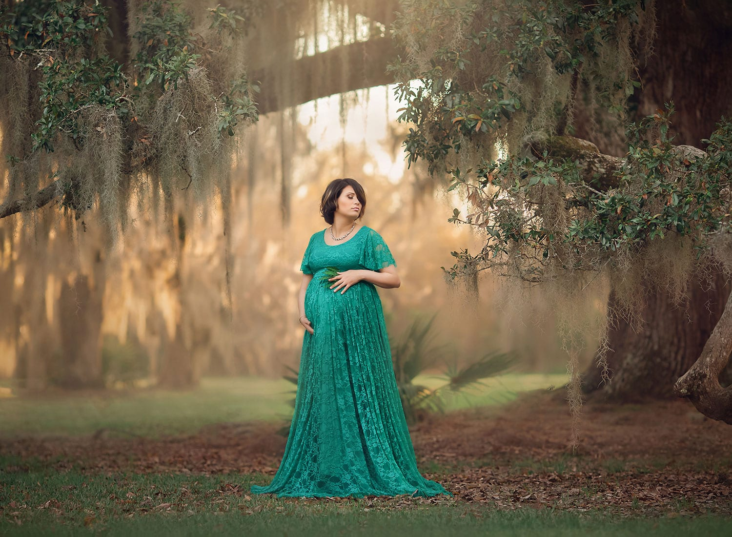 Fine Art maternity photo of expecting mother in teal dress at sunset