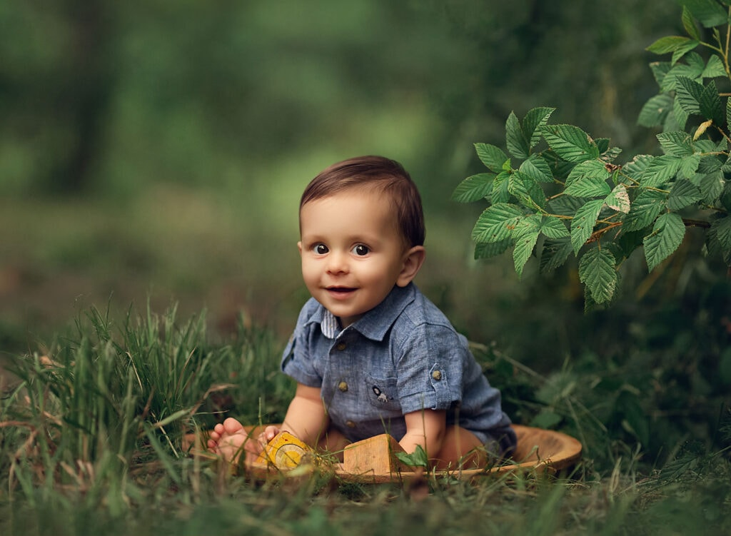 baby boy in bowl with yellow blocks