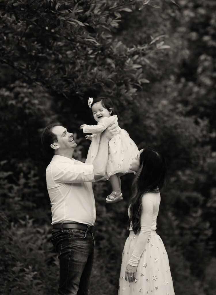 black and white photo of mom and dad with baby