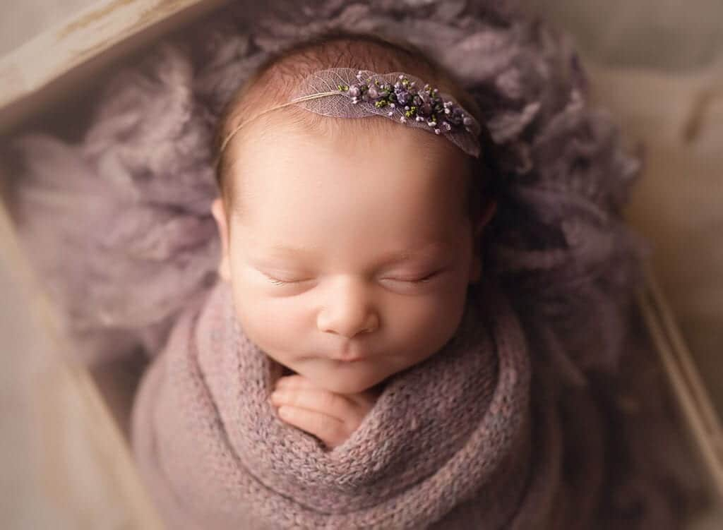 perfectly wrapped newborn