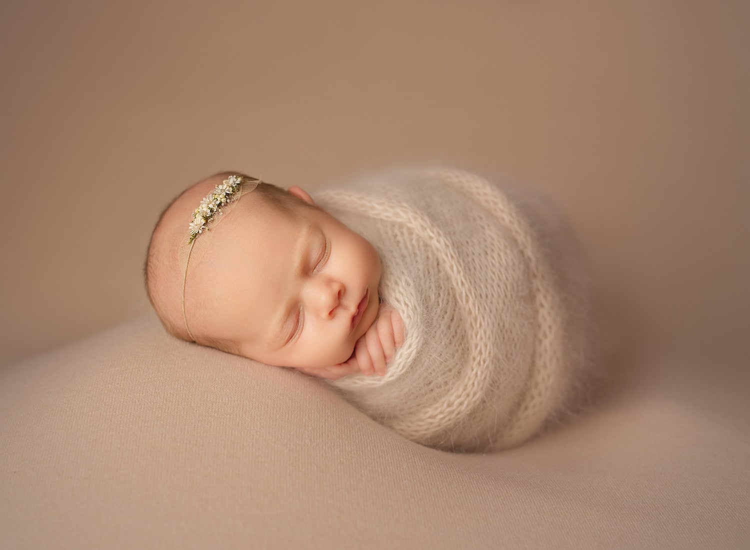 newborn girl wrapped in a ball