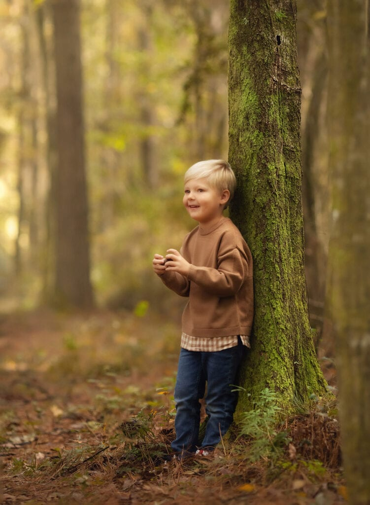 fine art photo of boy in forest