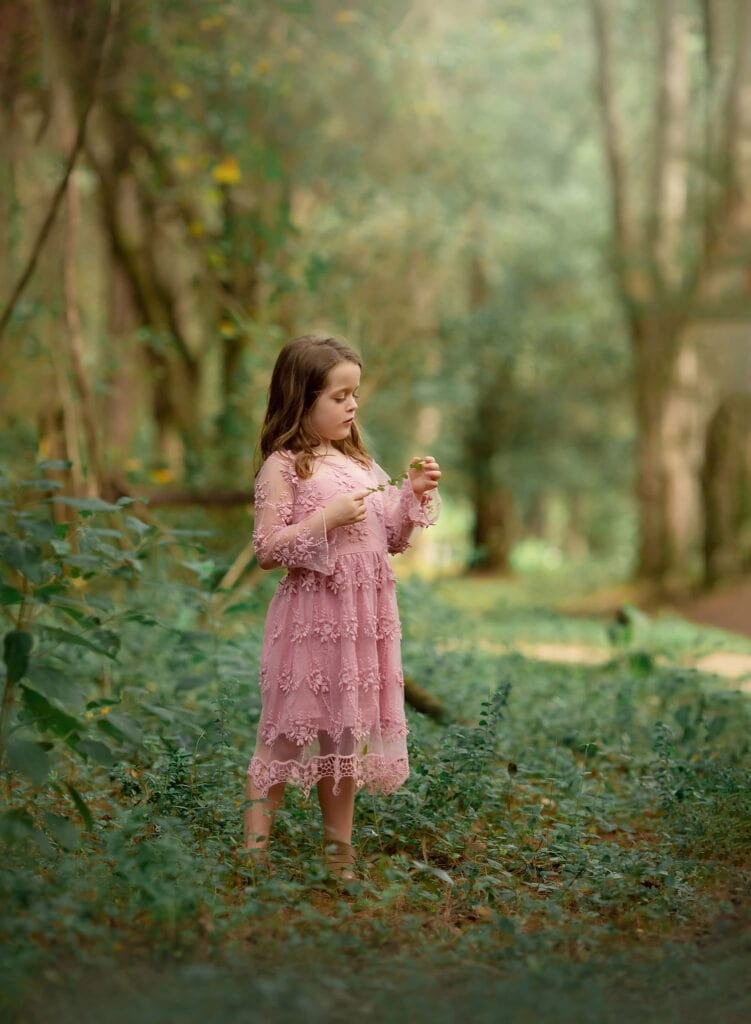 girl in forest in pink dress