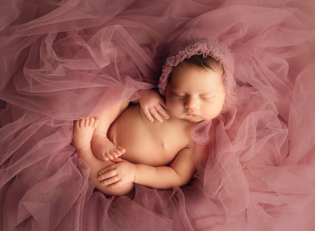 fine art photo of newborn girl in tulle