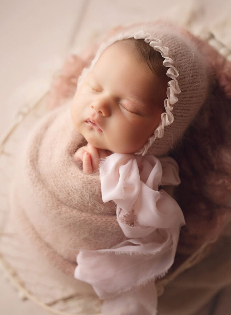 newborn girl in angora wrap